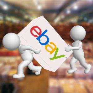 Imagen de dos monigotes levantando una caja con el símbolo de eBay